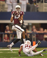 STAFF PHOTO BEN GOFF  @NWABenGoff -- 09/27/14 Texas A&M wide receiver Edward Pope catches a pass under pressure from Arkansas cornerback Jared Collins during the fourth quarter of the Southwest Classic at AT&T Stadium in Arlington, Texas on Saturday September 27, 2014. Pope ran the ball for a touchdown on the play.