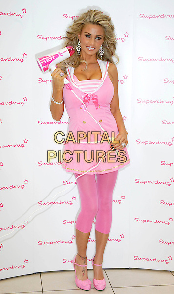 JORDAN - KATIE PRICE .Launches Jordan Haircare Electricals at Superdrug, Kensington High Street, London, England..October 25th 2007.full length pink dress top hairdryer leggings shoes .CAP/ROS.©Steve Ross/Capital Pictures