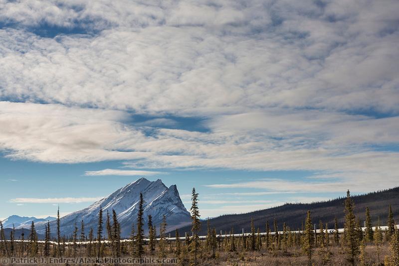 Trans Alaska pipeline traverses the tundra in front of mt Sukakpak of the Brooks Range.