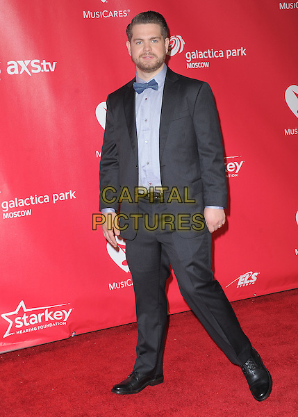 Jack Osbourne.The MusiCares 2013 Person Of The Year Tribute held at The Los Angeles Convention Center, West Hall in Los Angeles, California, USA..February 8th, 2013.full length suit blue bow tie black beard facial hair tuxedo.CAP/RKE/DVS.©DVS/RockinExposures/Capital Pictures.