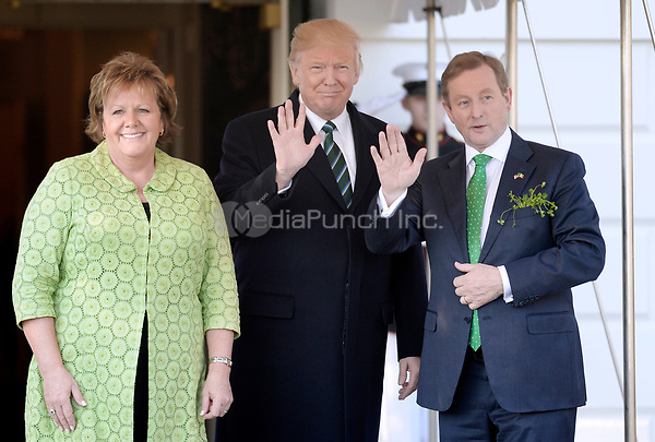 United States President Donald J. Trump  welcomes Prime Minister (Taoiseach) Enda Kenny of Ireland and his wife Fionnuala Kenny on the South Portico of the White House in Washington, DC on March 16, 2017 in Washington, DC. <br /> Credit: Olivier Douliery / Pool via CNP /MediaPunch