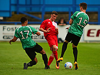 Lincoln City's Richie Burdett vies for possession with Gainsborough Trinity's Ellis Storey and Jack McGovern<br /> <br /> Photographer Andrew Vaughan/CameraSport<br /> <br /> Pre-Season Friendly - Gainsborough Trinity v Lincoln City - Saturday 15th July 2017 - The Gainsborough Martin &amp; Co Arena - Gainsborough<br /> <br /> World Copyright &copy; 2017 CameraSport. All rights reserved. 43 Linden Ave. Countesthorpe. Leicester. England. LE8 5PG - Tel: +44 (0) 116 277 4147 - admin@camerasport.com - www.camerasport.com
