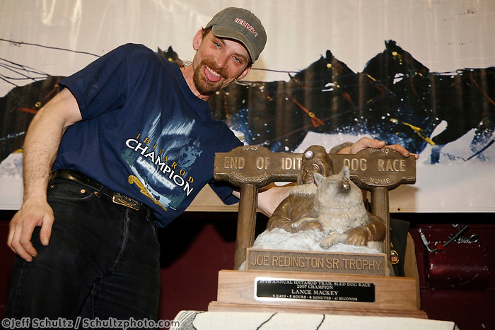 "2007 Iditarod champion Lance Mackey with his first place ""Joe Redington Sr."" tropy at the Nome awards banquet."