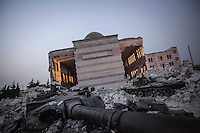 Syrian army tanks wreckage remain outside a mosque shattered during rough days of battles between rebel forces and the Syrian army to take control of the Azaz city.