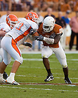 30 September 2006: Texas defender Brian Orakpo (#98) tangles with Sam Houston State offensive lineman Lance Hancock (#73) during the Longhorns 56-3 victory over the Sam Houston State Bearkats at Darrell K Royal Memorial Stadium in Austin, TX.