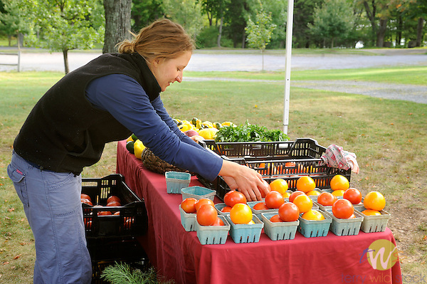 Shannon at Eagles Mere farmers market with organic vegetables.
