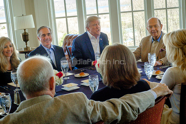 United States President Donald Trump has a working lunch with staff and cabinet members and significant others at his golf course, Trump National Golf Club in Potomac Falls, Virginia, U.S., on Saturday, March 11, 2017.  Seated around the table from left: Merle Bari Shulkin; US Secretary of Veterans Affairs David Shulkin; President Trump; US Secretary of Commerce Wilbur Ross; Louise Linton; Karen Hernest Kelly; and US Secretary of Homeland Security John F. Kelly. <br /> Credit: Pete Marovich / Pool via CNP /MediaPunch