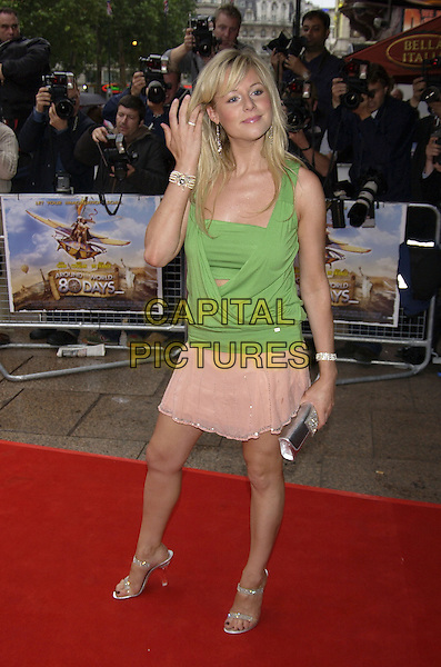 "ABI TITMUS.arrivals at premiere of.""Around the World in 80 Days"".Leicester Square, London.22 June 2004.CAP/PL.full length, green top, wrap around, pink skirt, silver sandals, bag, clutch purse.www.capitalpictures.com.sales@capitalpictures.com.©Capital Pictures"