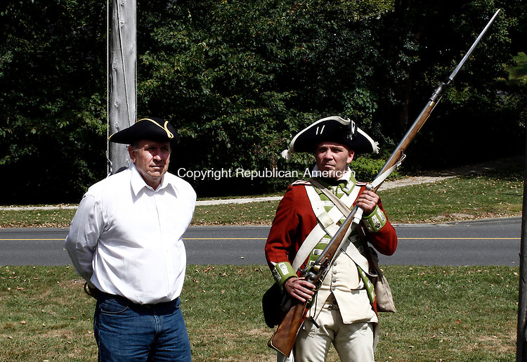WOODBURY, CT- 15 September 2013-091513CM12- Woodbury First Selectman, Jerry Stomski, left, is captured and guarded by  British Soldier, Steve Clark of Groton, CT during a reenactment skirmish from the Revolutionary War during a living history encampment at the Hurd House in Woodbury Sunday afternoon.  The event was part of the Colonial Day festivities.    Christopher Massa Republican-American