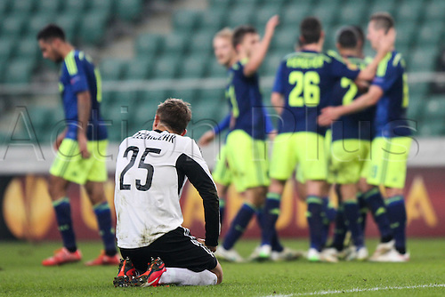 26.02.2015. Warsaw, Poland. Europa League football. Legia Warsaw versus Ajax.  Jakub Rzezniczak (Legia) upset as he team goes behind