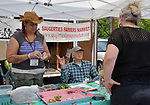 Market Manager, Christine Moss, with Market Committee member, Barry Benape, at the managers booth at the Saugerties Farmer's Market on Main Street in the Village of Saugerties, NY, on Saturday, June 10, 2017. Photo by Jim Peppler. Copyright/Jim Peppler-2017.
