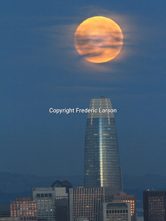 The October's full moon of over the San Francisco skyline.