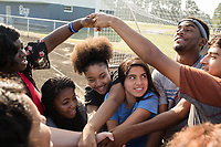 From left: Freshmen Quataysia Dixon, 14 (CQ) Armani Perkins, 14 (CQ), Jayla Wilkins ,14, (CQ) Gisell Cervantes ,14, (CQ) junior Tyreke Speight, 16, (CQ) and Dylan Mendez, 14, (CQ) form a human knot and try to untangle themselves. The students are part of the Peer Group Connection mentor program at Greene Central Central High School, and met each other during a field day. Snow Hill, NC Friday, September 22, 2017. (Justin Cook for Education Week)