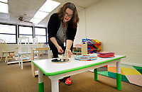 NWA Democrat-Gazette/DAVID GOTTSCHALK Candice Sisemore, owner and lead preschool teacher, begins to arrange Thursday, January 4, 2017, items in the Preschool classroom at Teeny Tiny Preschool in Fayetteville. Classes return Monday from the Christmas break at the school that opened in October. The program for children 18 months to 5 years old moved into the former Willow Heights Community building at 10 S. Willow Avenue and takes influence from the Reggio Emilia and Montessori pedagogies.