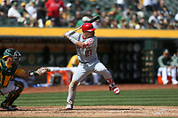 OAKLAND, CA - MARCH 31:  Mike Trout #27 of the Los Angeles Angels of Anaheim bats against the Oakland Athletics during the game at the Oakland Coliseum on Saturday, March 31, 2018 in Oakland, California. (Photo by Brad Mangin)