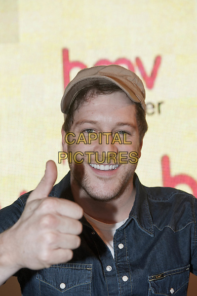 Matt Cardle celebrates the release of his highly anticipated debut album, 'Letters', with a free acoustic performance and signing session at HMV's flagship Oxford Street store in London, England..18th October 2011.stage concert live gig performance performing music in on headshot portrait blue denim shirt hat beige hat stubble facial hair hand thumb up.CAP/HT.©Hugh Thompson/Capital Pictures.