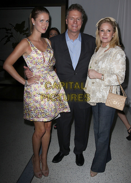 NICKY HILTON, RICK HILTON & KATHY HILTON.Fashion Designer Gilbert Chagoury First Ever Runway Show held At The Pacific Design Center, West Hollywood, California, USA..April 28th, 2010.full length bow sash waist yellow pink blue suit married husband wife father dad purple white pattern print floral print hand on hip mother mom mum daughter family jeans denim jacket pink bag purse .CAP/ADM/KB.©Kevan Brooks/AdMedia/Capital Pictures.