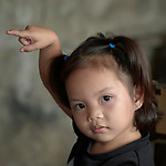 A girl raises her hand to ask a question in a preschool sponsored by the Kapatiran-Kaunlaran Foundation (KKFI) in Pulilan, a village in Bulacan, Philippines.<br /> <br /> KKFI is supported by United Methodist Women.