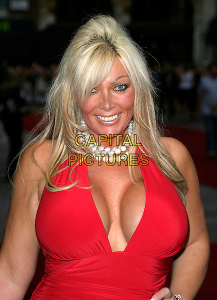 "LEA WALKER.At the UK Film Premiere of ""You, Me & Dupree"",.Odeon Leicester Square, London, England, .August 22nd 2006..half length big brother 7 red halterneck dress low cut cleavage fake boobs breasts plastic surgery pearl necklace beads bracelet hand on hip.Ref: AH.www.capitalpictures.com.sales@capitalpictures.com.©Adam Houghton/Capital Pictures."