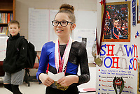 NWA Democrat-Gazette/DAVID GOTTSCHALK  Makenna Doyle, a fifth grade student at Lincoln Middle School, portrays a wax figure of olympic gold medalist in gymnastics Shawn Johnson Friday, March 16, 2018, during the Career Fair Day at Lincoln Middle School. The fair featured representatives from 20 job fields visiting classrooms, the wax museum and student grant proposals for funding of school improvement projects.