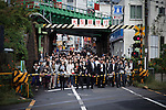 Tokyo, October 6 2011 - A crowd of Japanese workers waiting at a level crossing in Yoyogi station.