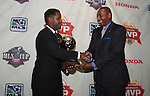 15 November 2007: Issaac Gooden (r) of American Honda Motor Company presents the 2007 MLS Honda MVP Award to DC United's Luciano Emilio (BRA) (l). The 2007 MLS Honda Most Valuable Player was announced at the ESPN Zone restaurant in Washington, DC three days before MLS Cup 2007, Major League Soccer's championship game.