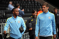 Raheem Sterling of Manchester City (L) arrives prior to the Premier League match between Swansea City and Manchester City at The Liberty Stadium in Swansea, Wales, UK. Saturday 24 September 2016