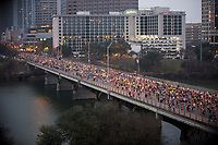 Thousands of Austin Marathon runners fill overtake the Congress Avenue Bridge after the starting pistol sounds during the annual Austin Marathon in downtown Austin, Texas.<br /><br />The Austin Marathon is an annual marathon held in Austin, Texas. It was founded in 1991 by Freescale Semiconductor, who served as title sponsor for fifteen years.