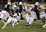 Nevada's Don Jackson runs from UC Davis defender Brandon Weaver during the second half of an NCAA college football game in Reno, Nev. on Thursday, Sept. 3, 2015. Nevada won 31-17. (AP Photo/Cathleen Allison)