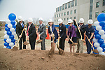 Administrators, staff, faculty, and students attend a groundbreaking ceremony for the new School of Medicine, School of Nursing, Physical Therapy and Orthopaedics building on Trent Drive, March 27, 2018. Digging into the soil, from left, are Cody Davis, Doctor of Physical Therapy student; Michel Landry, Chief of DPT; Benjamin Alman, Chair of Orthopaedics; Mary Klotman, Dean of School of Medicine; Eugene Washington, Chancellor for Health Affairs; Marion Broome, Dean of School of Nursing; Edward Buckley, Vice Dean for Education; and David Marsico, SoN student.