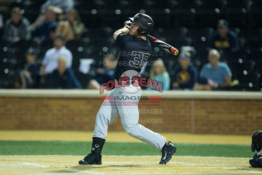 Ben Breazeale (39) of the Wake Forest Demon Deacons follows through on his swing against the West Virginia Mountaineers in Game Six of the Winston-Salem Regional in the 2017 College World Series at David F. Couch Ballpark on June 4, 2017 in Winston-Salem, North Carolina.  The Demon Deacons defeated the Mountaineers 12-8.  (Brian Westerholt/Four Seam Images)