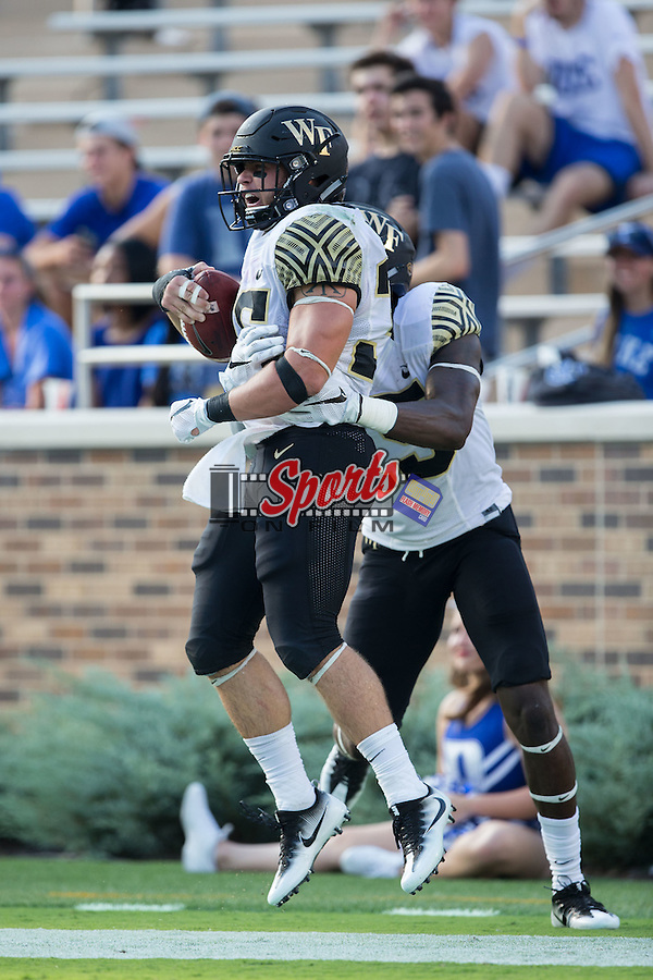 Cade Carney (36) of the Wake Forest Demon Deacons celebrates with teammate Cortez Lewis (15) after scoring his third touchdown of the game during second half action against the Duke Blue Devils at Wallace Wade Stadium on September 10, 2016 in Raleigh, North Carolina.  The Demon Deacons defeated the Blue Devils 24-14.  (Brian Westerholt/Sports On Film)