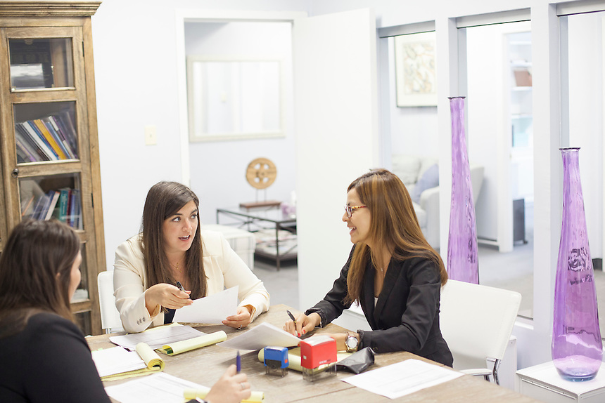 WASHINGTON, DC - MAY 9, 2014: Cate Edwards, center, talks with legal assistant Vivian Secaida, right, and law clerk Aida Faverio, left, during a staff meeting at the office of Edwards Kirby in Washington, DC on May 9, 2014. (Photo by Lance Rosenfield/Prime for The Washington Post)