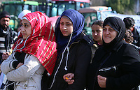 Pictured: Female migrants at the road block Tuesday 23 February 2016<br /> Re: Migrants on their way back to Athens have been caught by the blocked off motorway at Tembi, where local farmers have closed off the road, protesting against pension and welfare reforms near Trikala, Greece.