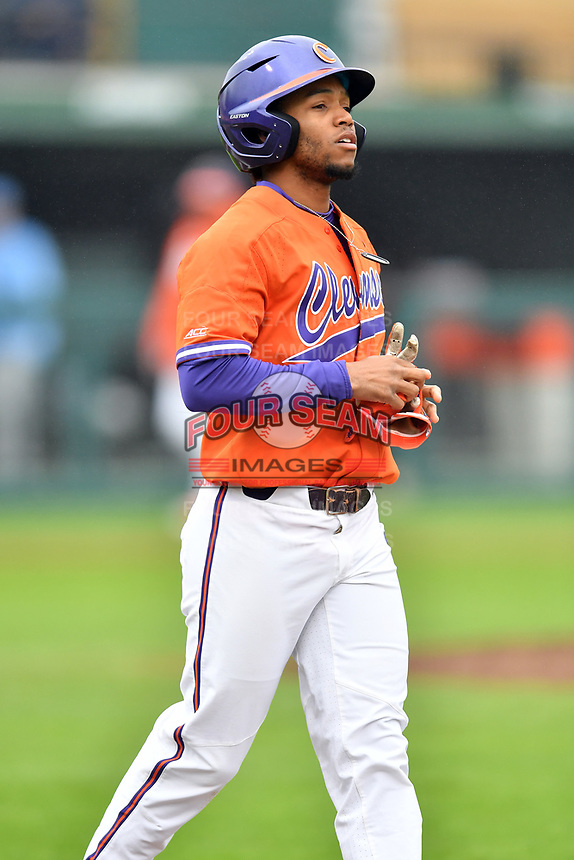 Clemson Tigers second baseman Jordan Greene (9) walks to first base during a game against the North Carolina Tar Heels at Doug Kingsmore Stadium on March 9, 2019 in Clemson, South Carolina. The Tigers defeated the Tar Heels 3-2 in game one of a double header. (Tony Farlow/Four Seam Images)