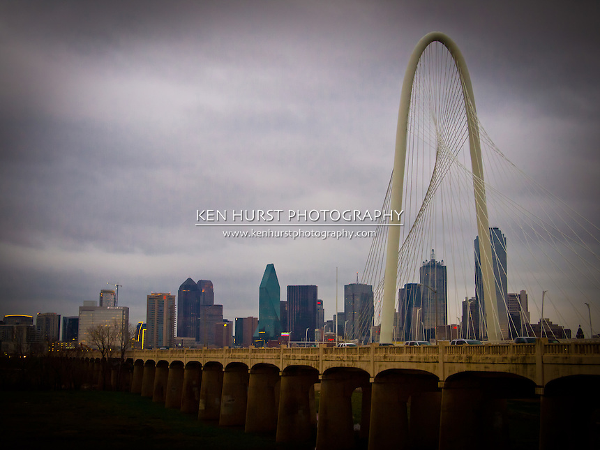The newly constructed (2012) Margaret Hunt Hill bridge, designed by Santiago Calatrava, running parallel to the older Continental Ave. bridge leading into Dallas, Texas.