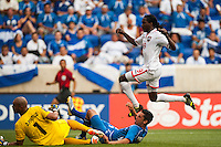 Trinidad and Tobago midfielder Keon Daniel (19) avoids El Salvador defender Steven Purdy Ramos (4) and goalkeeper Dagoberto Portillo (1) as he scores during a CONCACAF Gold Cup group B match at Red Bull Arena in Harrison, NJ, on July 8, 2013.