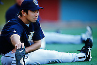 Hideo Nomo of the Milwaukee Brewers stretches before a 1999 Major League Baseball season game against the Los Angeles Dodgers in Los Angeles, California. (Larry Goren/Four Seam Images)