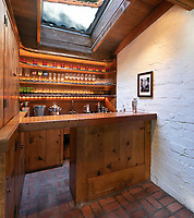 BNPS.co.uk (01202 558833)<br /> Pic: JimBartsch/DouglasElliman<br /> <br /> Snug bar.<br /> <br /> Goddesses and Monsters - Hacienda Style home from the halcyon days of Hollywood for sale.<br /> <br /> The enchanting former Beverly Hills home of both film icon Katharine Hepburn, and screen monster Boris Karloff has emerged on the market for £7million. ($8,95m)<br /> <br /> The four-time Oscar winning starlet lived at the 'hacienda' home when she first moved to Hollywood in the early 1930s.<br /> <br /> After finding fame, she sold it to Frankenstein actor Boris Karloff in the mid-1940s who bizarrely was a keen gardener and worked extensively on the landscaping.<br /> <br /> Another famous former owner of the single storey, five bedroom Spanish style residence, which has its own swimming pool and bar, is Animals frontman Eric Burdon, whose House of the Rising Sun, help fund its purchase in the 1960's.<br /> <br /> It is being sold with estate agent Douglas Elliman who describe it as 'a home fit for Hollywood royalty'.