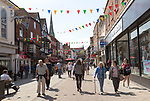 Busy pedestrianised shopping street in town centre, High Street, Salisbury, Wiltshire, England, UK