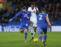 Bolton Wanderers' Sammy Ameobi under pressure from Cardiff City's Callum Paterson<br /> <br /> Photographer Kevin Barnes/CameraSport<br /> <br /> The EFL Sky Bet Championship - Cardiff City v Bolton Wanderers - Tuesday 13th February 2018 - Cardiff City Stadium - Cardiff<br /> <br /> World Copyright &copy; 2018 CameraSport. All rights reserved. 43 Linden Ave. Countesthorpe. Leicester. England. LE8 5PG - Tel: +44 (0) 116 277 4147 - admin@camerasport.com - www.camerasport.com