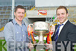 Kerry team mates Kieran O'Leary Dr Crokes  and Darren O'Sullivan Mid Kerry get their hands on the Bishop Moynihan cup on Monday but which one of them will be lifting it after this Sunday's Garvey's Super Valu County Championship final between Dr Crokes and Mid Kerry in Fitzgerald Stadium