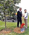 SUZHOU, CHINA - APRIL 16:  Colin Montgomerie (L) of Scotland and Miss Xu Hong, Chairperson of Jinji Lake Golf Club, pose for the media after planting a tree during the Round Two of the Volvo China Open on April 16, 2010 in Suzhou, China. Photo by Victor Fraile / The Power of Sport Images