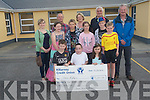 Shane McGlynn from Kilcummin accepting a cheque from the local community who held a fund-raising walk for him.<br /> Front L-R Danny Crowley, Shane McGylnn, Lorna O'Sullivan. <br /> Middle L-R Aishlinn Adair Byrne, Alex Mihailous Aileen Keane, Kyle O'Connor Coffey and Cathal Brosnan. <br /> Back L-R Aoife O'Mahony, Robert Keane, Deirdre McGlynn, Daniel Hughes and Paddy O'Sullivan.