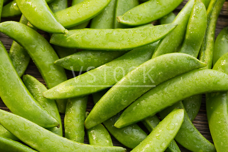 Green peas in pea pods