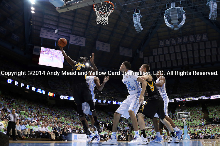 03 December 2014: Iowa's Gabriel Olaseni (ENG) (0) takes a shot. The University of North Carolina Tar Heels played the University of Iowa Hawkeyes in an NCAA Division I Men's basketball game at the Dean E. Smith Center in Chapel Hill, North Carolina. Iowa won the game 60-55.