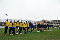 Bath players line up for a minute silence prior to the match. Amlin Challenge Cup match, between Bath Rugby and Bucharest Wolves on January 19, 2013 at the Recreation Ground in Bath, England. Photo by: Patrick Khachfe / Onside Images