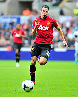 Robin Van Persie on the ball.<br /> Saturday 17 August 2013<br /> Pictured: <br /> Re: Barclays Premier League Swansea City v Manchester United at the Liberty Stadium, Swansea, Wales