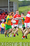 Darragh O'Sullivan Dingle in action against PJ Murphy and John Sheehan Gneeveguilla in the opening round of the Kerry Senior Football Championship on Sunday in Dingle.