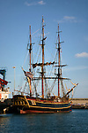 Four sailors working in the rigging  of the Bounty tall ship, docked in Santa Cruz harbour. Tenerife,Canary Islands.